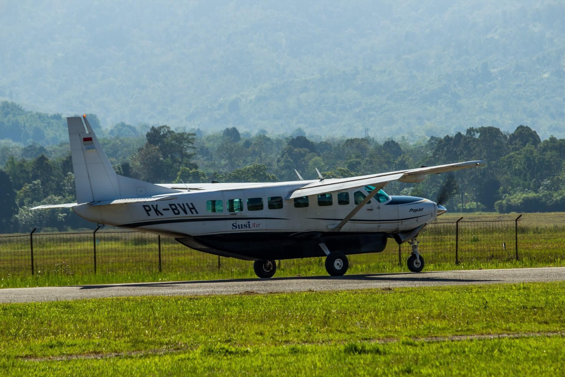 Susi Air plane takeoff, Depati Parbo airport, Kerinci, Jambi, Sumatra, Indonesia travel to kerinci